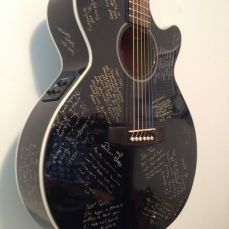 This student decided to have his classmates sign his guitar instead of a yearbook for his graduation. I sealed it in with a few coats of clear Nitro lacquer to preserve it forever!
